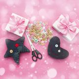 Soft handmade toys. Materials for artistic buttons, scissors, toy star. Royalty Free Stock Photo