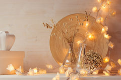 Soft home decor with burning lights on white wooden background. royalty free stock photos