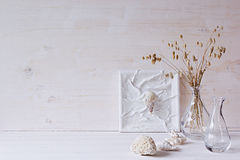 Free Soft Home Decor. Seashells And Glass Vase With Spikelets On White Wood Background. Stock Photography - 78567292
