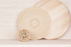 Soft home decor of  wooden plate and stems on white wood background. Interior Royalty Free Stock Photography