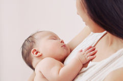 Soft image of newborn baby with mother Stock Photo