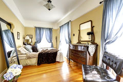 Soft ivory bedroom with antique furniture Stock Photography