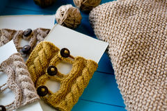 Soft knitted blanket, yarn balls lying on background Stock Images