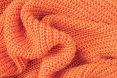 Soft knitted fabric from orange fluffy yarn royalty free stock photos