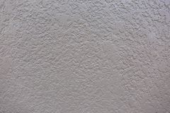 Soft Knockdown Sand Cement Stucco Texture on Wall. This is a perfect display of knockdown soft cement stucco on an exterior wall. A great texture background for royalty free stock photo