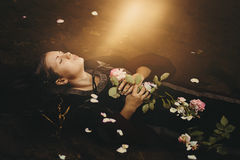 Soft light over floating dead woman Royalty Free Stock Photos
