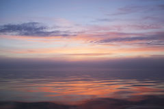 The soft light of sunset and sea. Sunset in pink, yellow and blue colors of the sea Royalty Free Stock Images