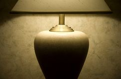 Soft light from table lamp. Table lamp against soft patterned wallpaper Royalty Free Stock Image