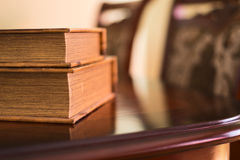 Soft lighted books on table. Old ancient book composition over the table as a home interior background Stock Images