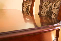 Soft lighted table and chairs. Photo of softly illuminated table and chairs as a home interior background Stock Images