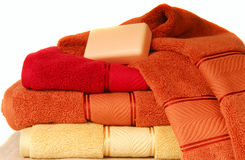 Soft luxurious towels with a bar of soap Royalty Free Stock Photo