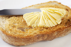 Soft Margarine and Toast. Soft, heart healthy, polyunstaurated margarine being spread onto crunchy toast Stock Photo