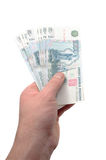 Soft money in hand Stock Image