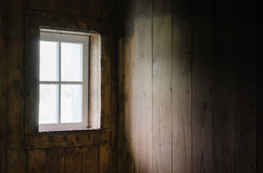 Soft Natural Window Light on Barn Board Interior. Royalty Free Stock Photography