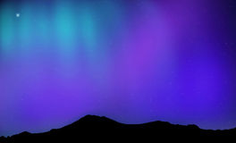 Soft northern lights in the mountains Royalty Free Stock Photo
