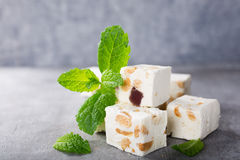 Soft nougat blocks with peanuts Stock Images