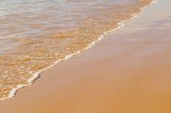Soft ocean wave on the sandy beach Royalty Free Stock Photos