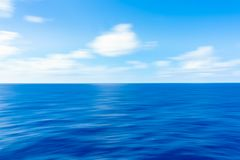 Soft Ocean Waves. With White Clouds against a blue sky stock images