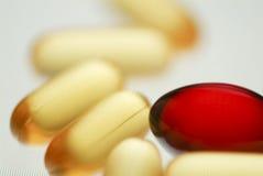 Soft orange pills with syringe soft focus macro. Top view Stock Image