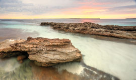 Soft pastel colours of a sunrise at Hyams Beach Australia stock photos