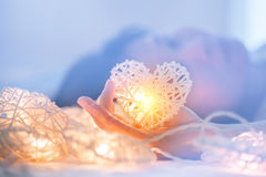 Soft pastel Orange Lamp in Bamboo baskets in the heart shape on Two hand Royalty Free Stock Images