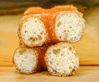 Soft pastries sprinkled with sugar into a bowl Royalty Free Stock Photography