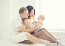 Soft photo happy family at home in white room Stock Images
