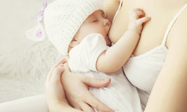 Soft photo mother feeding breast her baby royalty free stock photos