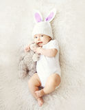 Soft photo of sweet cute baby in knitted hat with a rabbit ears Stock Photography