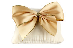 Soft pillow decorated with a bow Royalty Free Stock Photos