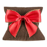 Soft pillow and decorative bow on Royalty Free Stock Image