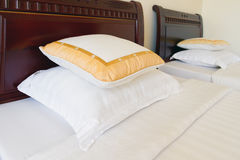 Soft pillows on the bed Stock Photography
