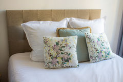 Soft pillows on a comfortable bed Royalty Free Stock Image