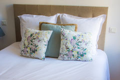 Soft pillows on a comfortable bed Royalty Free Stock Photo