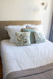 Soft pillows on a comfortable bed Stock Photos