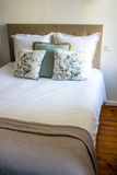 Soft pillows on a comfortable bed Stock Photography