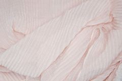 Soft pink pleated fabrice background. Soft pink pleated fabrice. Plisse fabric texture background Royalty Free Stock Photo
