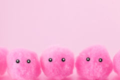 Soft pink pompoms faces Stock Photos