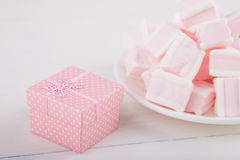 Soft pink and white marshmallow with gift box on white backgroun Stock Image