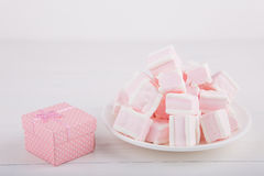 Soft pink and white marshmallow with gift box on white backgroun Royalty Free Stock Images