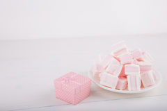 Soft pink and white marshmallow with gift box on white backgroun Stock Photography