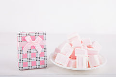 Soft pink and white marshmallow with gift box on white backgroun Royalty Free Stock Image