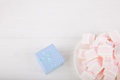 Soft pink and white marshmallow with gift box on white backgroun Stock Images