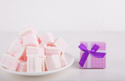 Soft pink and white marshmallow with gift box on white backgroun Stock Photos