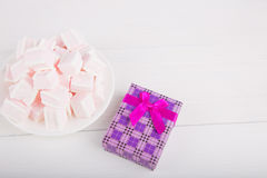 Soft pink and white marshmallow with gift box on white backgroun Royalty Free Stock Photo