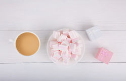 Soft pink and white marshmallow with gift boxes and cup of coffe Royalty Free Stock Photography