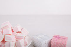 Soft pink and white marshmallow with gift boxes on white backgro Royalty Free Stock Photography