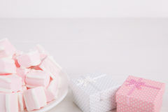 Soft pink and white marshmallow with gift boxes on white backgro Royalty Free Stock Image