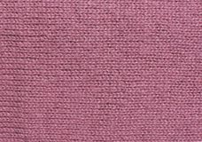 Pink fuchsia knitwork. Soft pink wool knitwork background texture. Wool knitwork full frame for warming backdrop or background Stock Photos