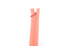 A soft pink zipper. On white backgrounds Royalty Free Stock Photo